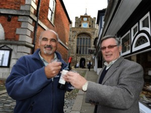 Friends reunited: Winchelsea's Richard Commotto and Rye's Anthony Kimber toast the successful renovation of Rye's landmark clock