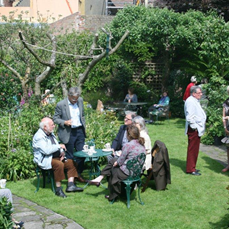 Conservation conversations: partygoers enjoying the beautiful garden