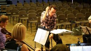 Conductor Alisdair Kitchen at rehearsal