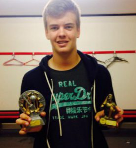 15 year old Joe Fraser with both his player of the year award for the 4th team and his award for his century against  St Peters.
