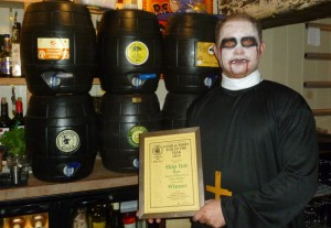 Theo shows off his CAMRA certificate as well as his Halloween outfit