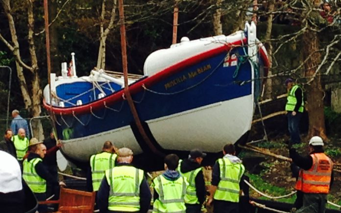 The Pricisilla MacBean lifeboat is lowered into dry dock