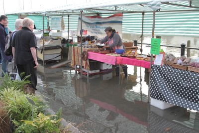 Shoppers retreat from the rising tide while the French Delicatessen deploys a ramp to stay dry