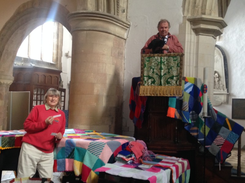 Verger Tony Dagleas and church cat Sylvester Frost survey the finished blankets from the pulpit. Sandra Lanigan is below left