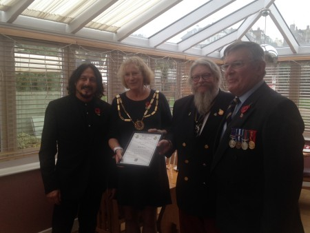 Bugler Michel Duvoisin, Mayor Bernadine Fiddimore and Neale East and Col. Anthony Kimber from the Royal British Legion