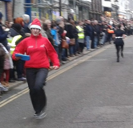 Cheers and partisan support as teams set off on several laps of the High Street for the Christmas Pudding race