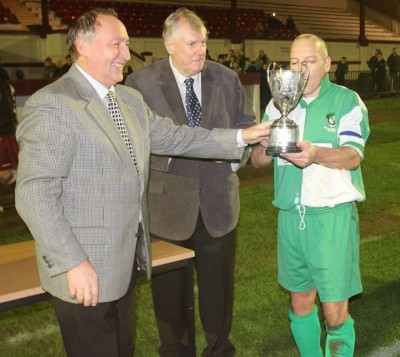 Captain Mike Beaumont receiving the trophy