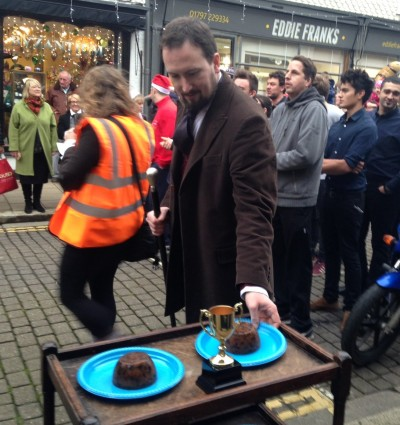A competitor weighs up the Xmas pudding before the race begins