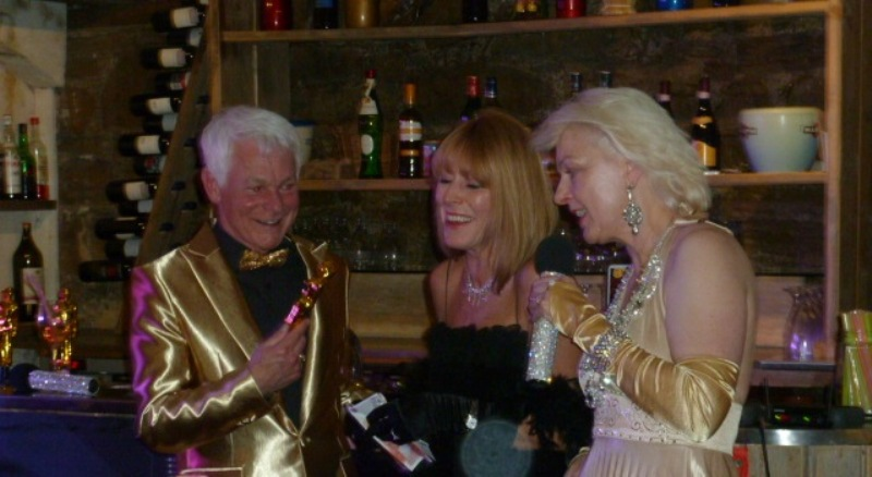 The Blings (left and right) with one of the night's winners Lyn Venn (centre)