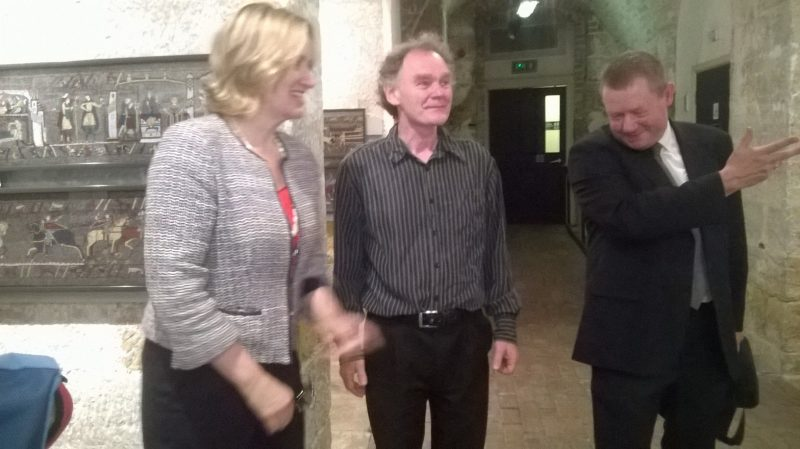 Amber Rudd (Rye and Hastings MP) meets creator of the mosaic panels, Michael Linton, a recreation of the Bayeux Tapestry, introduced by Kevin Bourman on the right
