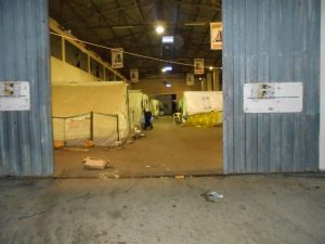 Tents inside the warehouse at Diveni refugee camp
