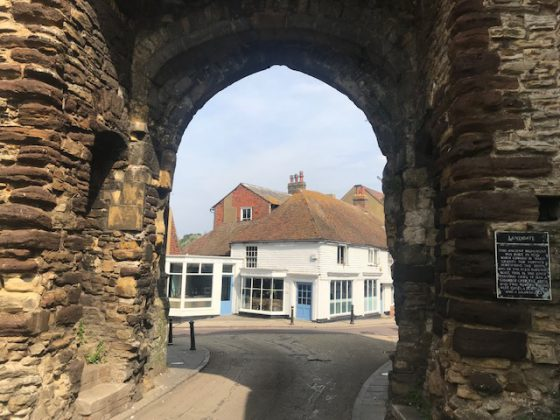 The Landgate arch frames the Outside Inn